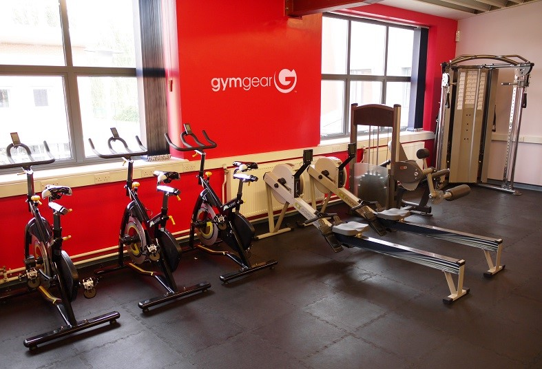 The gym is equipped with exercise bikes and rowers